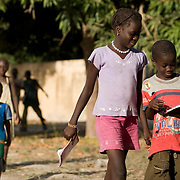 Children walk to school in the village of Bourofaye, Senegal, on Wednesday June 13, 2007.