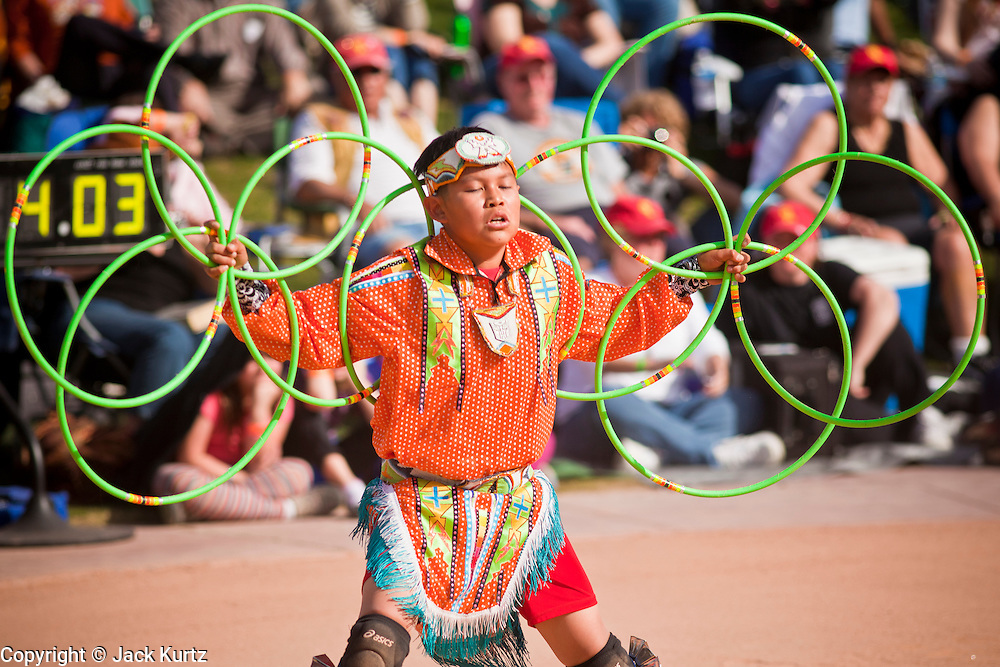 06 FEBRUARY 2011 - PHOENIX, AZ: TYRESE JENSEN, a Navajo/Maricopa from Dilkon, AZ, performs at the 21st Annual Heard Museum World Championship Hoop Dance Contest at the Heard Museum in Phoenix, AZ, Sunday, February 6. Hoop dancing has a long tradition among Native American peoples. The hoop or circle is symbolic to most Native people. It represents the Circle of Life and the continuous cycle of summer and winter, day and night, male and female. Some native people use hoop dancing as a part of healing ceremonies designed to restore balance and harmony in the world.      Photo by Jack Kurtz