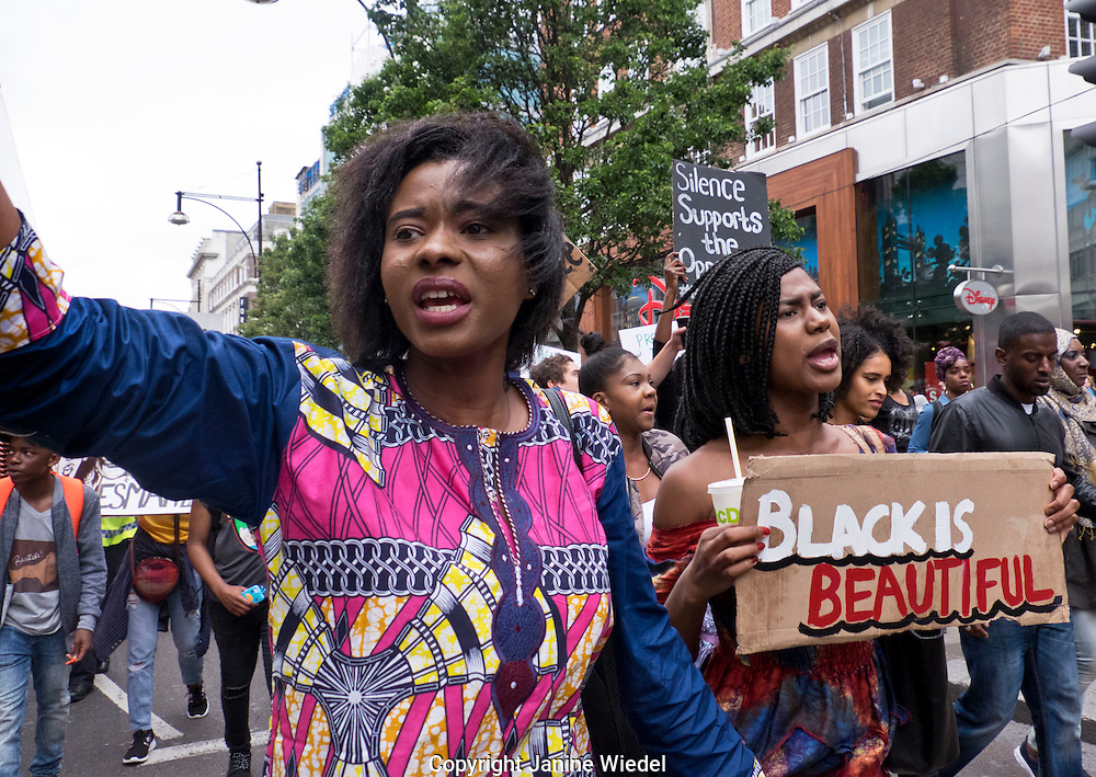 """""""Black Lives Matter""""  Over a thousand people marched through London chanting """"hands up don't shoot"""".  The black community was outraged by US police brutality after killing of two black men - one in Minnesota and one in Louisiana."""