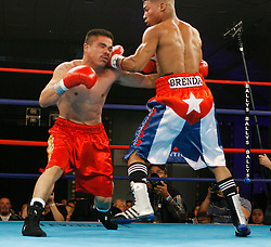 January 5, 2008; Atlantic City, NJ, USA;  Yoriokis Gamboa (red/white/blue trunks) and Gilberto Luque (red trunks) trade punches during their bout at the Grand Ballroom of Bally's Hotel and Casino in Atlantic City, NJ.   Gamboa, the Cuban flyweight gold medalist at the 2004 Summer Olympics, defected to Germany to begin a pro career.  He won his eighth in a row via 1st round KO.