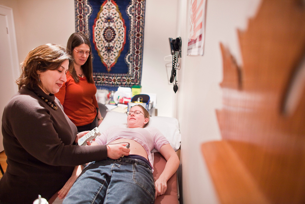 London, Ontario ---10-02-16---  Midwife Mojgan Nadafi, left, and her colleague Janis Dalacker examine client Lynn Conforzi who is 19 weeks pregnant at Thames Valley Midwives in London, Ontario, February 16, 2010. In Iran, Mojgan was a well regarded academic in midwifery with her masters degree yet when she immigrated to Canada she had difficulty getting her qualifications recognized.<br /> GEOFF ROBINS The Globe and Mail