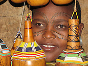 Africa, Tanzania, members of the Datoga tribe Woman in traditional dress, beads and earrings. Beauty scarring can be seen around the eyes, April 2007