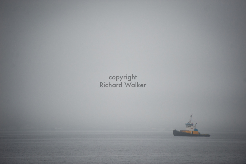 2013 October 24 - A tug boat sails in heavy fog on Puget Sound off Alki, Seattle, WA. By Richard Walker