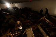A man reads an army file in the looted ammo storage in the army barracks in Banghazi on Feb. 25, 2011.