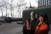 """New York, NY - November 05, 2013 : Veteran Scott Riley with his daughters Hasha Riley, left, and Libra Riley-Johnson, right, at the New York City Vietnam Veterans Memorial Plaza in New York, NY on November 05, 2013. Vet Scott Riley spent 30 years after her came back from Vietnam as a drug addict. Then he got clean and wrote a book--""""Grace in the Wilderness"""" with his two daughters."""