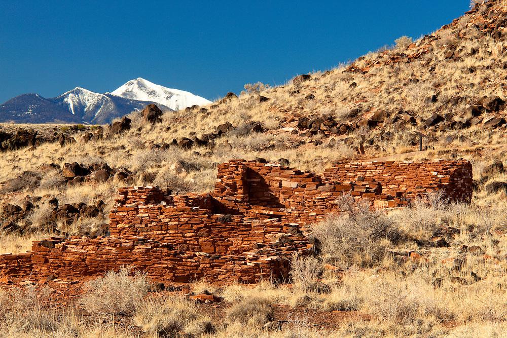 Pueblo ruins at Wupatki National Monument. In the distance is Humphreys Peak. Near Flagstaff, Arizona.