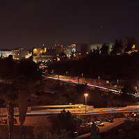 Night traffic on Derech Hevron and Hativat Yerushalayim passes the Sultan's Pool on the way to the Jaffa Gate in Jerusalem's Old City. WATERMARKS WILL NOT APPEAR ON PRINTS OR LICENSED IMAGES.