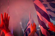 People wave their hands toward  Adonis Samaras at the speech for the New Democracy party in Zappeio, Athens, Greece. Image © Angelos Giotopoulos/Falcon Photo Agency