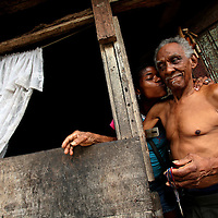 A man gets a kiss on the cheek in his house in San Miguel, a poor barrio in Panama City, Panama on Saturday, September 8, 2007. (Photo/Scott Dalton).