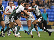Reading, GREAT BRITAIN, Falcon James GRINDAL, is tackle by left Nils MORDT and right Delon ARMITAGE,  during the Guinness Premiership match London Irish vs Newcastle Falcons, at Madejski. England, Sun. 23.09.2007  [Mandatory Credit, Peter Spurrier/Intersport-images].....