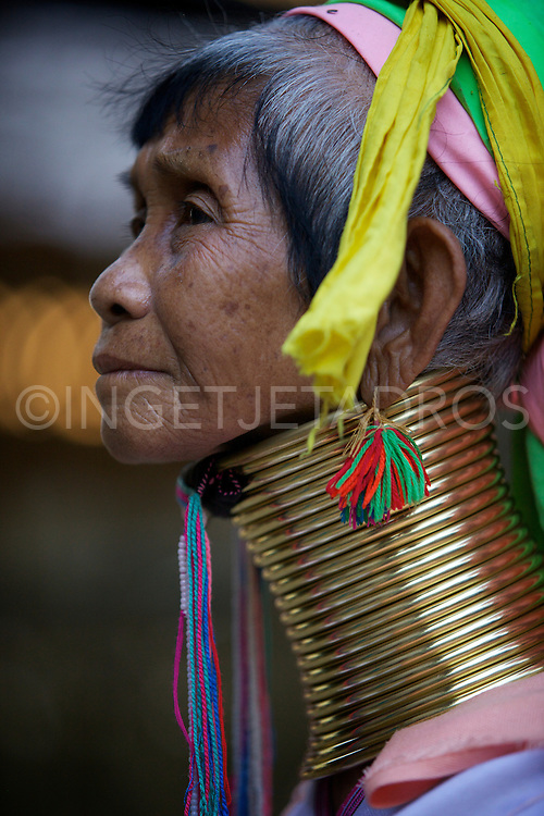 The Kayan are an ethnic minority of Burma (Myanmar). The Kayan Lahwi is the group whose women identify themselves by wearing large neck rings, brass coils that are placed around the neck.<br /> Girls first start to wear rings when they are around five years old. Over the years the coil is replaced by a longer one and more turns are added. (some can weigh around 5 kg).<br /> <br /> The Kayan live in the hills in Northern Thailand in the provence of Mae Hong Son. In the late 1980's due to a conflict with the military regime in Burma, many Kayan tribes fled to the Thai border. Among the refugee camps set up there was a Long neck section, which became a tourist site, self-sufficient on tourist revenue and not needing financial assistance.<br /> Nai Soi, Mae Hong Son, Thailand 2013<br /> &copy;Ingetje Tadros