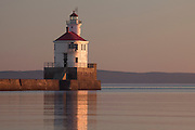 WI00176-00...WISCONSIN - Sunrise at Wisconsin Point Lighthouse on Lake Superior near the town of Superior.