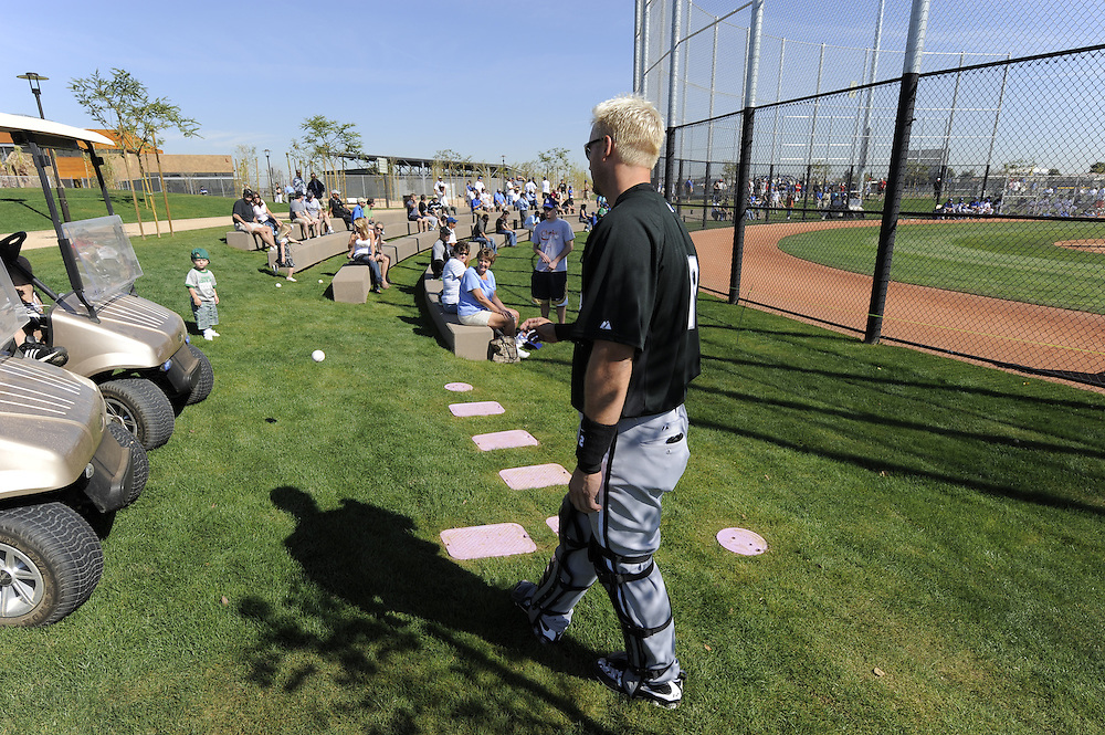 """GLENDALE, AZ - FEBRUARY 26:  A.J. Pierzynski #12 of the Chicago White Sox plays catch with a young fan during a """"B"""" game between the Los Angeles Dodgers and Chicago White Sox on February 26, 2009 at Camelback Ranch in Glendale, Arizona. (Photo by Ron Vesely)"""