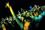 A crowd member dances during the NAS and Damion Marley set at the 2010 Gathering of the Vibes in Bridgeport, Connecticut on August 21, 2010. © Brian Jenkins/3rd Stone Images