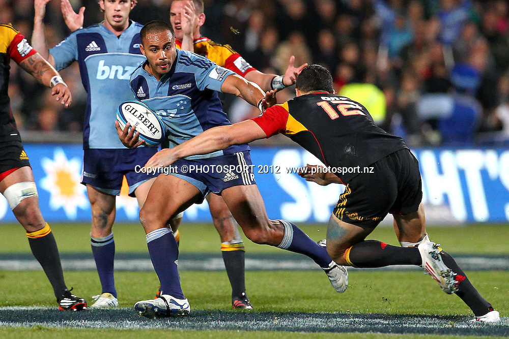 Blues' Rudi Wulf fends against Chiefs' Sonny Bill Williams. Super Rugby rugby union match, Blues v Chiefs at North Harbour Stadium, Auckland, New Zealand. Saturday 2nd June 2012. Photo: Anthony Au-Yeung / photosport.co.nz