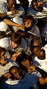 The Gilman football team celebrates their 28-0 defeat of McDonogh in a MIAA A Conference game  at McDonogh.