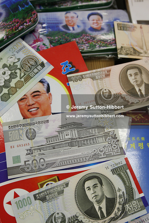 "Mr. Jun Miyagawa, of the Rainbow Trading Company ( a North Korean speciality bookstore) shows off the North Korean products he has for sale ( including Kim Il Sung badges, North Korean bank notes, football memorabilia, cigarettes, and North Korean propaganda posters and genuine North Korean military uniforms), in his book store in Jimbocho district,  Tokyo, Japan, Friday, Aug. 17, 2007. All the products come via a contact of Mr Miyagawa's in China. The posters are individually painted and range in price from ¥50,000-¥150,000, the Kim Il Sung badges cost approximately JPN Yen 4,000. The products are bought mainly by Japanese 'North Korea fans"", or as Mr. Miyagawa put it ""by Japanese who have a healthy obsession with North Korea""."