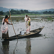 Assam, May 2004. A vaccination team uses a small boat to reach remote areas on the Brahmaputra flood plain.