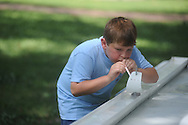 John Victor Arbuckle uses a straw to power a sail boat as the Boy Scouts celebrated their 100th birthday in the Grove at Ole Miss in Oxford, Miss. on Saturday, July 31, 2010.