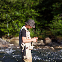 WA09160-00...WASHINGTON - Fly fishing on the Middle Fork of the Snoqualme River near North Bend. (MR# J9)