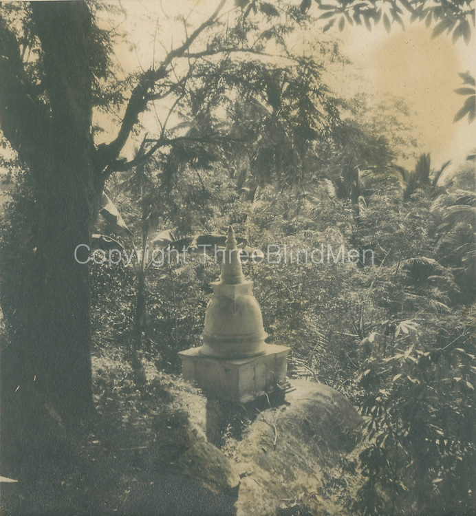 Small stupa in landscape.<br />