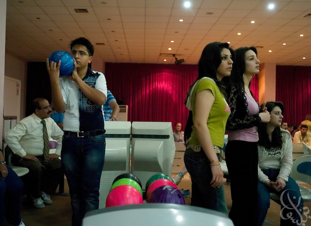 Kurdish teens enjoy a recently opened Kurdish bowling alley May 24, 2007 in Sulamaniya, Iraq. The three story entertainment complex houses bowling, an arcade and a food court and is one of many investments by Kurds returning to their homeland from abroad with new investment ideas for the region. .
