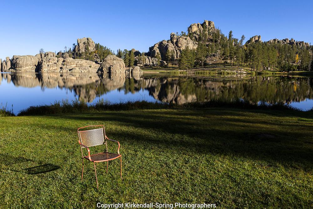 SD00066-00...SOUTH DAKOTA - Empty chair at Sylvan Lake in Custer State Park.