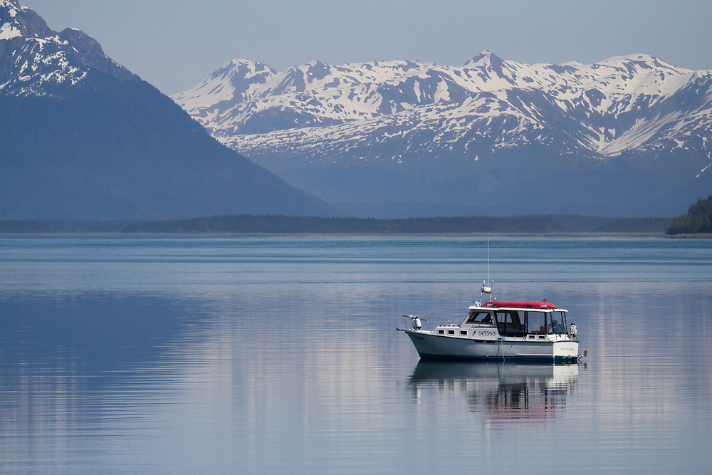 A recreational boat rests at anchor in Glacier Bay National Park.
