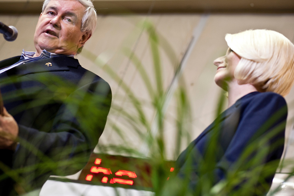 Republican presidential candidate Newt Gingrich and his wife Callista Gingrich hold a rally at his campaign office on Monday, January 2, 2012 in Davenport, IA.
