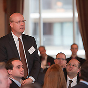 Bruce Whitacre, guest, asks question of the panelists. The Manhattan Chamber of Commerce Annual Economic Outlook Breakfast was held at the New York Athletic Club in New York on April 4, 2011. The breakfast was sponsored by Wells Fargo.