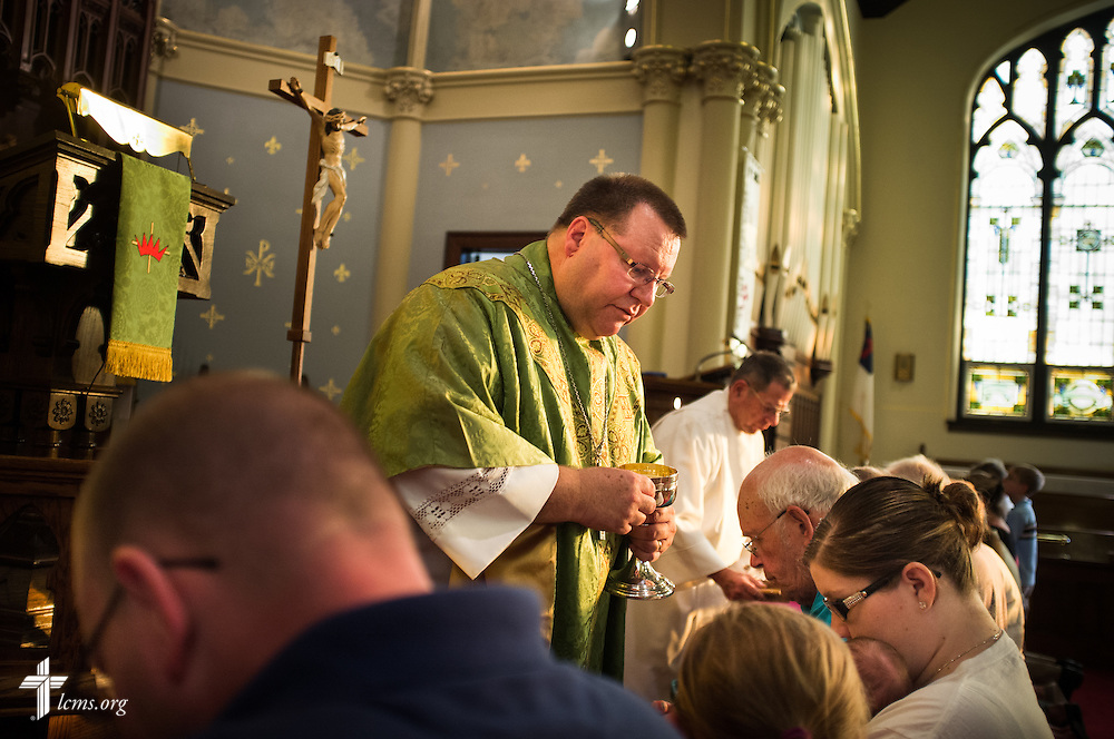 The Rev. Kent Tibben distributes the Sacrament to parishioners during Divine Service at Trinity Lutheran Church on Wednesday, July 15, 2015, in Danville, Ill. LCMS Communications/Erik M. Lunsford