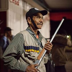 A member of the Citizen Council (inspired in the Community Police) prepares to patrol the streets of Huamuxtitl·n.  Huamuxtitl·n communities, conformed more from mestizo people, started their own community police group in 2011, after living kidnappings in the town in complicity with local authorities, including ministerial police and mayoress. / Un miembro del Consejo Ciudadano (inspirado en la PolicÌa Comunitaria) se prepara para patrullar en las calles de Huamuxtitl·n.  Las comunidades de  Huamuxtitl·n comenzaron su propio grupo de justicia en 2011, llamado Consejo Ciudadano e inspirado en la PolicÌa Comunitaria, despuÈs de sufrir secuestros en complicidad con autoridades locales que incluÌan a la policÌa ministerial y la alcaldesa.   (Photo: Prometeo Lucero)