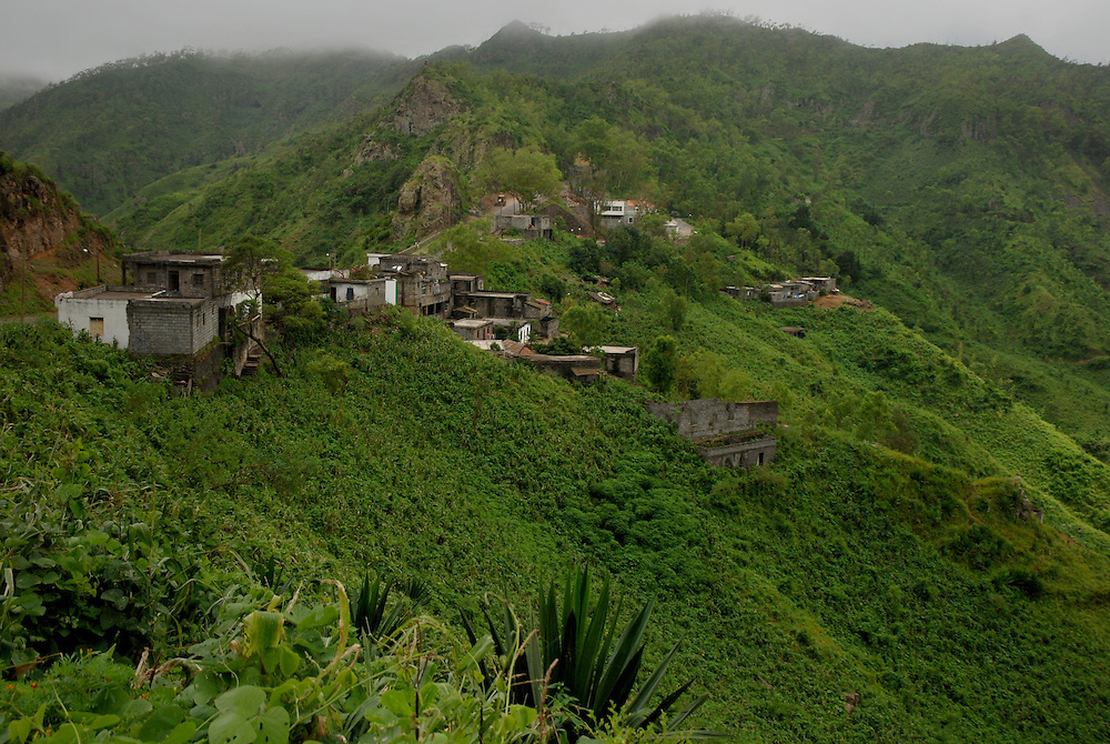Buildings cling to the steep mountainside.  Central mountain range, Santiago Island, Cape Verde (Capo Verde).