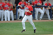 Ole Miss' Matt Tracy (29) scores on a Ole Miss' Miles Hamblin (24) single vs. Lipscomb at Oxford-University Stadium in Oxford, Miss. on Sunday, March 13, 2011. Ole Miss won 5-1 to sweep the series and improve to 13-4.
