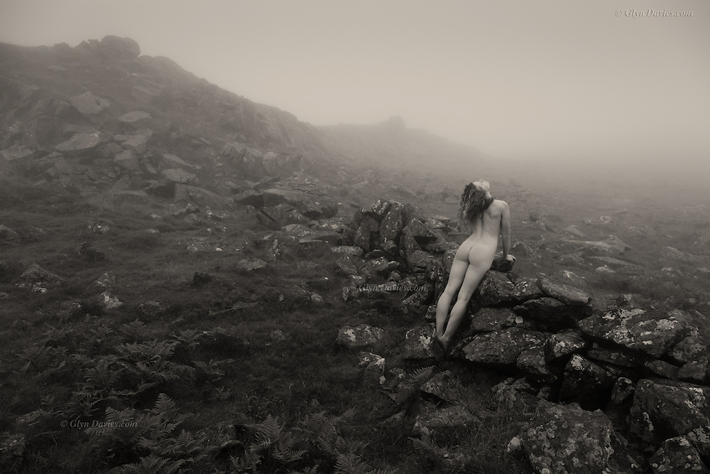 &ldquo;Mist Touches&rdquo; by Glyn Davies<br /> <br /> (From his major exhibition project, &ldquo;Landscape Figures&rdquo;)<br /> <br /> <br /> &ldquo;It&rsquo;s the season of mist and fog, as remnants of warm air linger throughout autumn and into winter, caressing the cooling, softened landscape. Yet the weather can still be uplifting for those who are aware, for the gentle flow of condensed air carries resonant memories of sunny days, laughter, friends and cold wine. Ahead we look forward to the new life that spring brings and we build powerful and positive dreams for hot days to come and another clothes free summer. <br /> <br /> So winter is neither frightening nor negative, though understandably will be for some poor souls, but in it&rsquo;s own way it&rsquo;s a dramatic and wonderful cleansing, wiping the slate clean for the year ahead. For those of us lucky enough to be healthy &amp; able, we should revel in the sensuous conditions of autumn and wrap ourselves in its elemental cloak to truly feel connected to the changing seasons.&rdquo;<br /> <br /> &quot;Landscape Figures&quot; explores the relationship between organic human figures and a notional 'wild landscape'. <br /> <br /> &ldquo;Although the nude is vital to the project and integral within the images, the images are not just &lsquo;nudes&rsquo; &ndash; they are landscapes and stories. In a way they are just simple, beautiful, dreamlike visual questions&rdquo;.