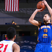 Santa Cruz Warriors Forward Mychel Thompson (15) attempts a jump shot as Delaware 87ers Guard Melvin Johnson (21) looks on in the second half of a NBA D-league regular season basketball game between the Delaware 87ers and the Santa Cruz Warriors (Golden State Warriors) Tuesday, Jan. 13, 2015 at The Bob Carpenter Sports Convocation Center in Newark, DEL