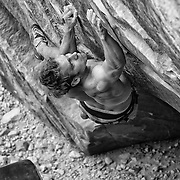 "South African climber Arjan De Kock attempting ""The Nest"" V15, in the Red Rock Conservation Area near Las Vegas Nevada."