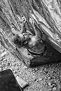 """South African climber Arjan De Kock attempting """"The Nest"""" V15, in the Red Rock Conservation Area near Las Vegas Nevada."""