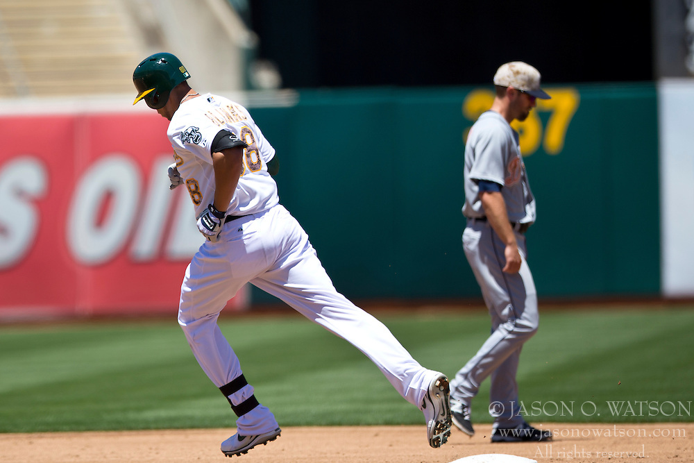 OAKLAND, CA - MAY 26:  Kyle Blanks #88 of the Oakland Athletics rounds the bases after hitting a home run off of Drew Smyly #33 of the Detroit Tigers (not pictured) during the second inning at O.co Coliseum on May 26, 2014 in Oakland, California. The Oakland Athletics defeated the Detroit Tigers 10-0.  (Photo by Jason O. Watson/Getty Images) *** Local Caption *** Kyle Blanks