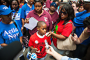 Nine-year-old protestor Asean Johnson speaks outside City Hall in a one-day boycott of CPS schools in Chicago, IL.