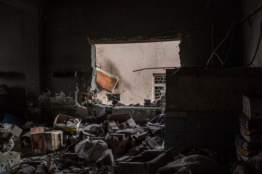 DEBALTSEVE, UKRAINE - FEBRUARY 8, 2015: The aftermath of shelling that hit near a medical treatment point for Ukrainian fighters in Debaltseve, Ukraine. Fighting between pro-Russia rebels and Ukrainian forces there over the past two weeks has dealt steady casualties to Ukrainian fighters and civilians. CREDIT: Brendan Hoffman for The New York Times