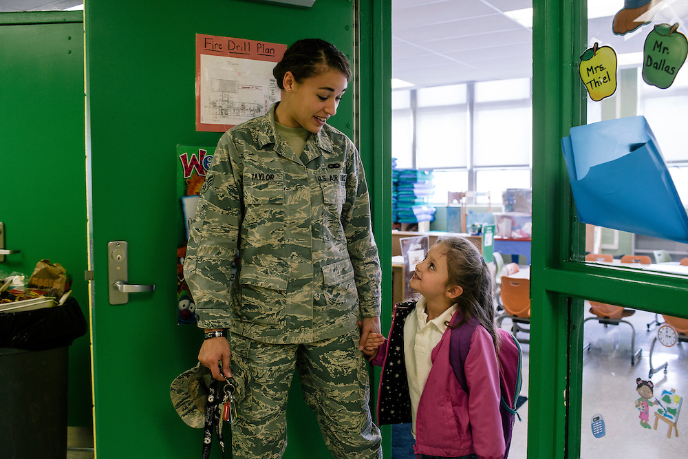 Haley Taylor of the Air Force picks up her daughter Makayla Raap, 4, from Leckie Elementary School on Monday, March 16, 2015. Taylor, a recent transfer to the Joint Base Anacostia-Bolling, said even though Makayla only started in school a month ago, has made a really smooth transition.