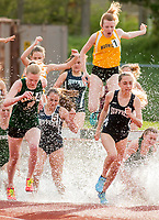 New Windsor, New York - High school girls compete in the 3,000-meter steeplechase on the track at Cornwall High School on May 1, 2017.