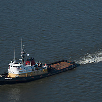 Aerial view of the USS Washington being pulled down the delaware river starting trip to seattle for dismantlement into a museum