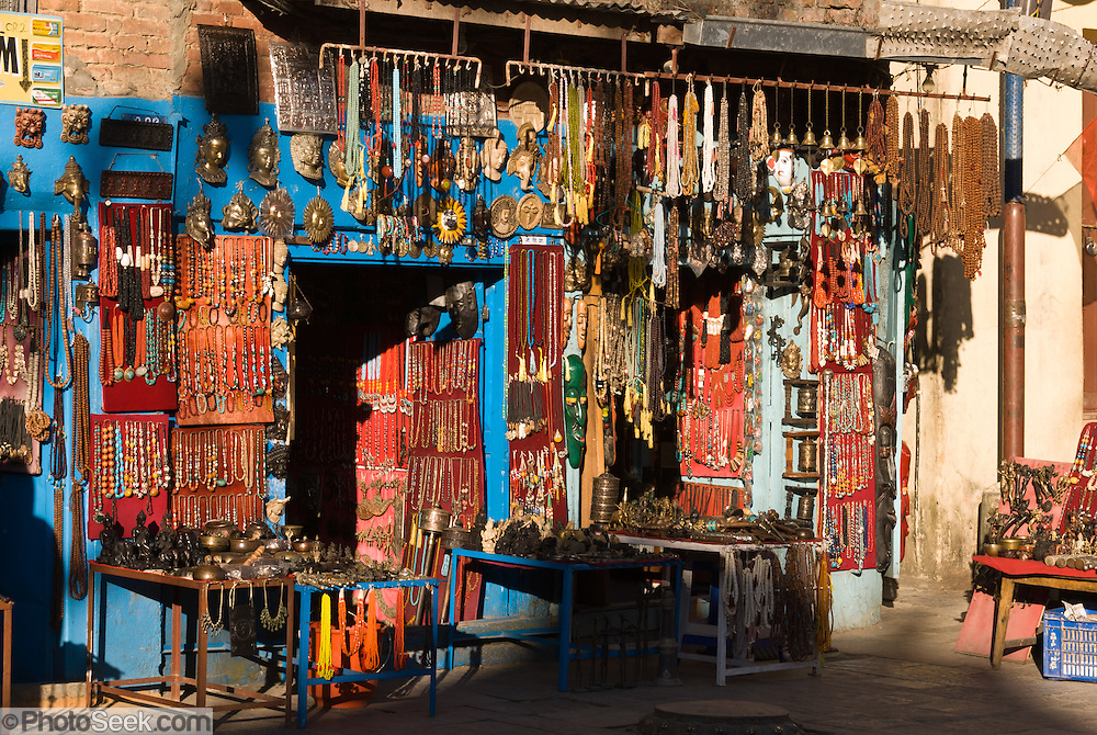 "Handicrafts are sold (necklaces, prayer wheels, carved objects, metal casts) along the walkways to Swayambhunath, the Buddhist ""Monkey Temple"", a religious site founded about 500 AD, one of the oldest and holiest Buddhist sites in the Kathmandu Valley. Swayambhunath sits on a hill in western Kathmandu overlooking the city in Nepal, Asia."