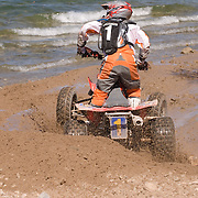 With a comfortable lead, Pro Rider Doug Eichner (#1), checks out the lake view during the Pro Main.