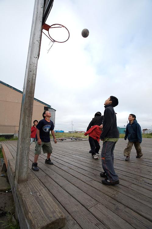 Children playing basketball in Newtok, Alaska. 2008