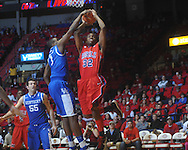 "Ole Miss guard Zach Graham (32)  has his shot blocked by Kentucky's Darius Miller (1) at the C.M. ""Tad"" Smith Coliseum in Oxford, Miss. on Tuesday, February 1, 2011. Ole Miss won 71-69."