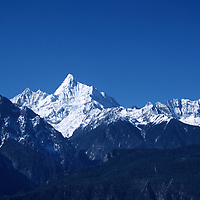 """MEILI MOUNTAIN, DECEMBER 17, 2000:  a view of Mt. Meili in deqin county, Yunnan province , December 17, 2000..Mt. Meili is the highest peak in Yunnan province and according to supporters from Deqin county, it's a """"proof"""" that the 'real"""" Shangri-La is located in deqin county. The fictuous Mt. Karakal which is described in James Hilton's Lost Horizon, alledgedly is modelled on Mt. Meili in Yunnan province.."""