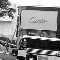 A bus passes the Cartier store in Tumon, Guam, on Saturday, Mar. 10, 2007.  Sometimes known as 'America in Asia', Guam is a popular destination for Japanese tourists ( accounting for approx 90% of the island's visitors) with average visitor numbers from Japan approaching 1million.  The island, a 3.5 hour flight from Japan, has more than 20 large hotels and numerous duty-free shopping malls catering to the Japanese tourists predilection for designer brand name goods, as well as golfing and other water based entertainment features. In 2007-2008 US military personal currently stationed in the Japanese Okinawan Islands will relocate their bases and operations  to Guam, helping to stabilise the island's economy which suffered after tourism decreased in recent years due to a  fear of flying by Japanese post 9-11 World Trade Centre disaster, a 2003 typhoon and the SARS disease outbreak in Asia.
